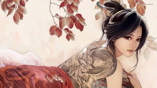 woman-tattoo-dragon